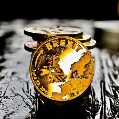 Gold brexit coin. Europe leaving.