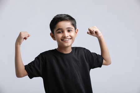 Photo for little Indian / Asian boy showing attitude over white background - Royalty Free Image