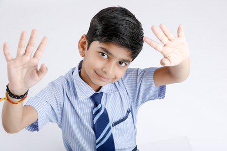 Photo for Cute little indian Indian / Asian school boy wearing uniform - Royalty Free Image
