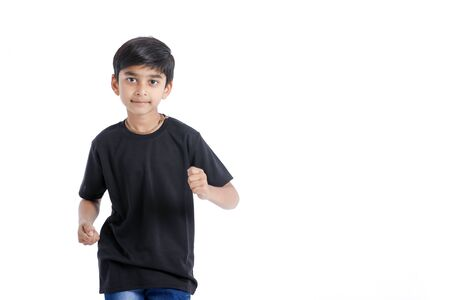 Photo for Cute Indian little boy playing , running and giving multiple expression - Royalty Free Image