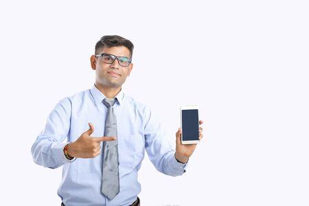 Photo pour indian business man showing smartphone - image libre de droit