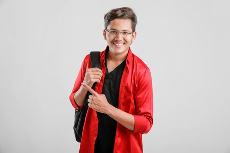 Photo for Handsome Indian / Asian college male student carrying bag - Royalty Free Image