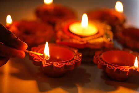 Photo for Diwali or festive of lights. Traditional Indian diwali  festival, woman hands holding oil lamp, with defocus light background. - Royalty Free Image