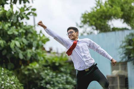 Foto für Indian Student achieving success , Jumping in air - Lizenzfreies Bild