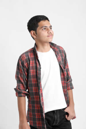 Photo pour Young indian boy in a casual outfit and showing expression on white background. - image libre de droit