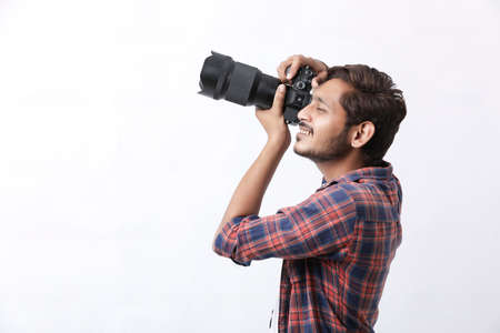 Photo pour Photographer With Camera on white background. - image libre de droit