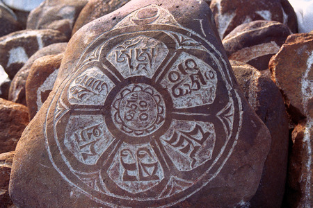 Pebbles from sacred Lake Manasarovar with hieroglyphs and main Buddhist mantra Om Mani Padme Hum, which can be translated as Oh Jewel in the Lotus Flower - precious of the Soul.