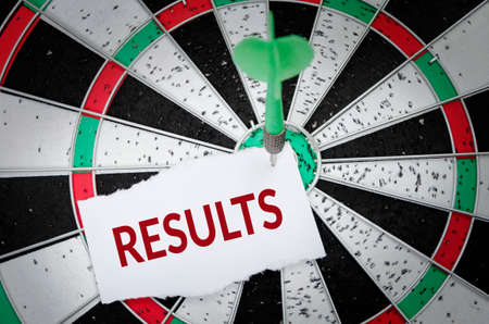 Results note on notepaper with dart arrow and dart board. Marketing, advertisement, business concept.