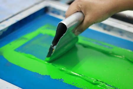 Photo for Hand pressing silk-screen printing, close up view. - Royalty Free Image