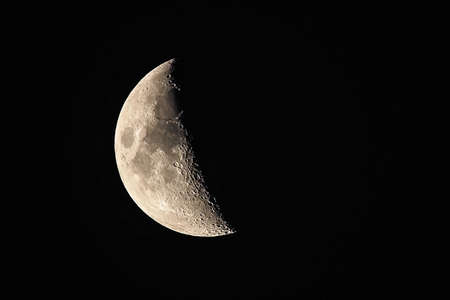 Foto de Moon background / The Moon as it appears early in its first quarter or late in its last quarter, when only a small arc-shaped section of the visible portion is illuminated by the Sun. - Imagen libre de derechos