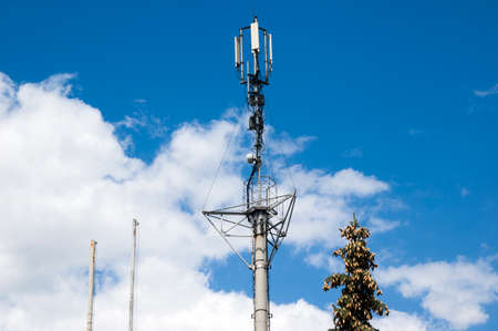 Photo for Telecommunication mast television antennas.Telecommunication GSM.Receiving and transmitting stations.Phone mast satellite 4g cell tower.Mobile phone antenna, telecommunication tower with clouds - Royalty Free Image