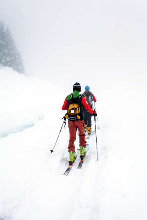 Photo for ski mountaineering excursion on a foggy day - Royalty Free Image