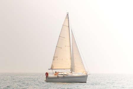 Photo pour solo regatta with sailboat - vintage - image libre de droit