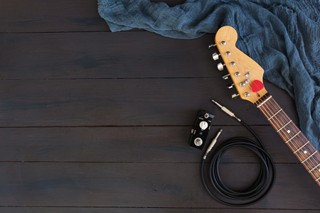Photo pour Electric guitar on dark background - image libre de droit