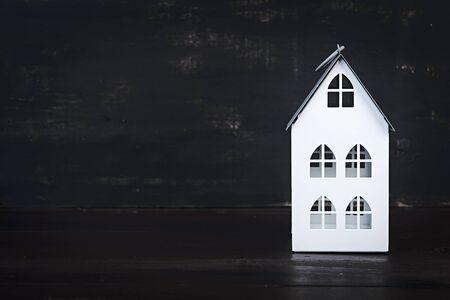 Photo pour Home sweet home. Home symbol on dark background. - image libre de droit
