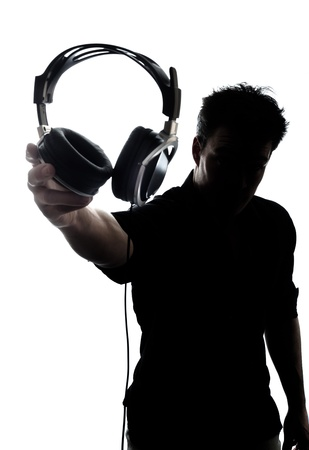 Male in silhouette showing headphones isolated on white background