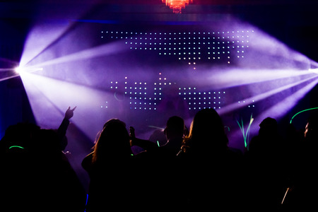 Photo for Crowd During a Party or Wedding reception in front of a DJ - Royalty Free Image