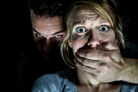 Woman Victim put to Silence by her Boyfriend - Domestic Violence Concept
