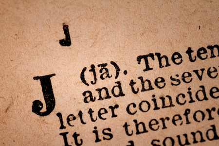 October 1st, 2015 - Montreal, Canada. Close-up of a J, the 10th Letter of the Latin Alphabet into a Old Pronunciation Dictionary