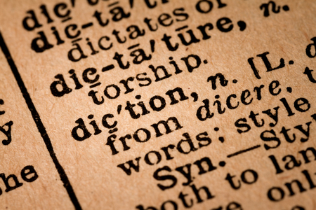 October 1st, 2015 - Montreal, Canada. Close-up of an Old 1945 Webster Vintage Dictionary showing the Word DICTION