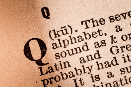 October 1st, 2015 - Montreal, Canada. Close-up of a Q, the 17th Letter of the Latin Alphabet into a Old Pronunciation Dictionary