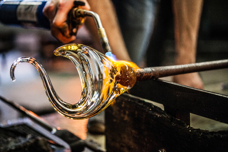 Photo pour Man Hands Closeup Working on a Blown Glass Piece - image libre de droit