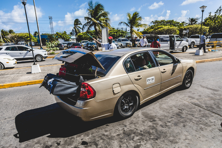 Photo for SAN ANDRES ISLAND, Colombia _ Circa March 2017. Taxi Company Taking the Luggage and Tourists at the Airport - Royalty Free Image