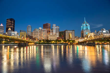Photo for City skyline view over the Allegheny River and Roberto Clemente Bridge in downtown Pittsburgh Pennsylvania USA - Royalty Free Image