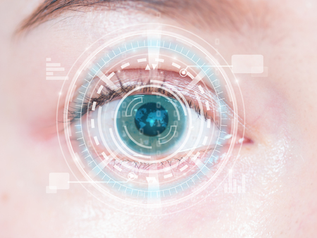 Close-up of woman\'s blue eye. High technology in the futuristic. scan, contact lens