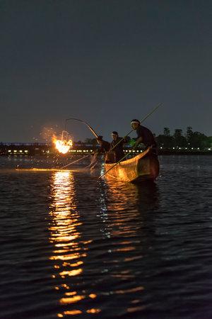 Cormorant fishermen fishing on the Katsura River in Arashiyama at night