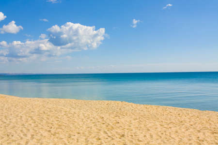 Seascape with calm blue sea, little clouds and sandy beach, recorded in Saint Constantine and Saint Helen resort, Bulgaria.