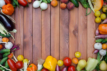 vegetables and fruits composition on wooden tableの写真素材