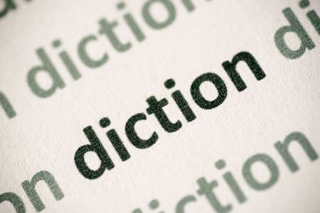 word diction printed on white paper macro