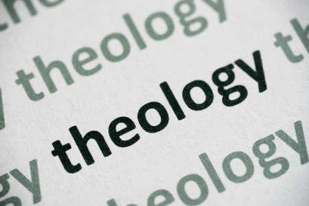 word theology  printed on white paper macro