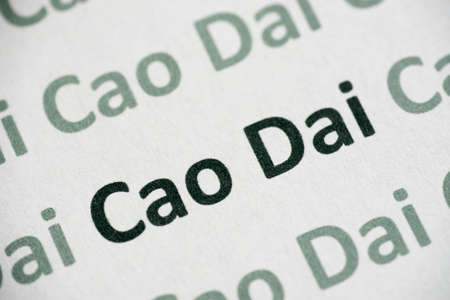 word Cao Dai printed on white paper macro