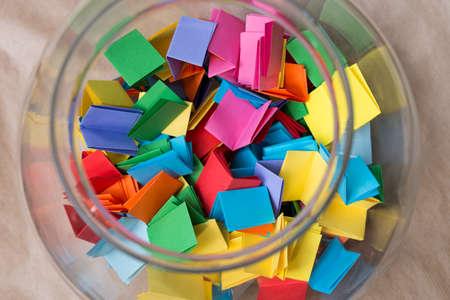 Foto de multicolored lottery tickets in jar closeup - Imagen libre de derechos