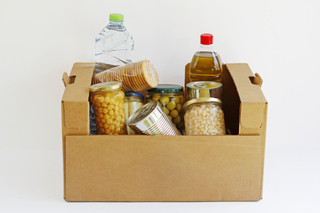 Food in a donation box, isolated in a white background