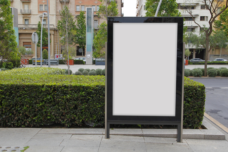 Photo for Blank billboard in the street, green plants - Royalty Free Image