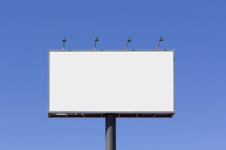 Photo for Blank billboard mock up for advertising, against blue sky - Royalty Free Image