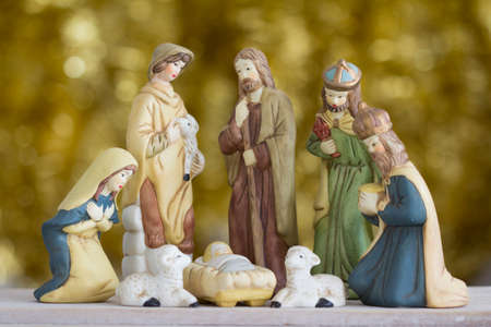 Photo for Nativity Scene with Baby Jesus, Mary, Joseph, a Shepherd and a Wise Man on a Golden Background - Royalty Free Image