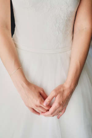Foto de The morning of the bride, when she wears a beautiful dress, a woman prepares before the wedding ceremony an exciting moment - Imagen libre de derechos