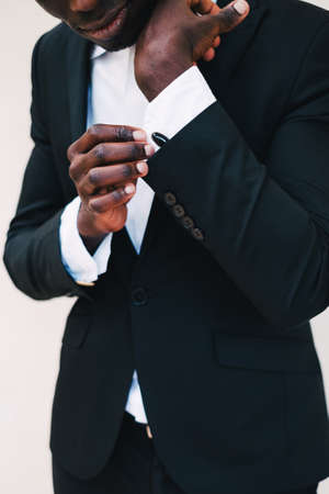 Foto de Close-up of a man in a tux fixing his cufflink. groom bow tie cufflinks - Imagen libre de derechos