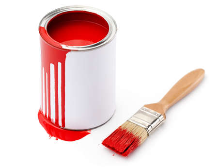 Full of red paint tin and paintbrush which is dirty with red ink, isolated on white background