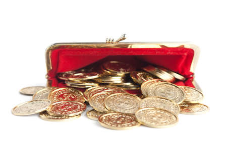 Scattered gold coins are in open hot red purse, isolated on white background  A great number of coins symbolise weath, richness, income and profit  Close up shot