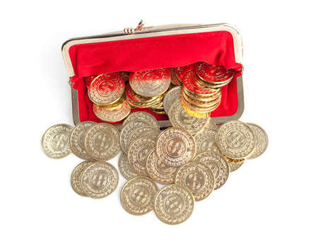 Scattered silver and gold coins are in red purse, isolated on white background  A great number of coins symbolise weath, richness, income and profit  Close up shot