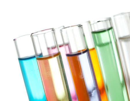 Group of test tubes with a colored liquids in a rack, isolated