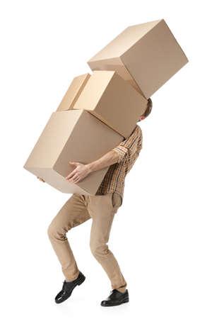 Foto de Man hardly carries the cardboard boxes, isolated, white background - Imagen libre de derechos