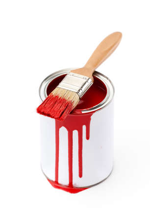 Full of red paint tin and paint brush which is dirty with red ink, isolated on white background