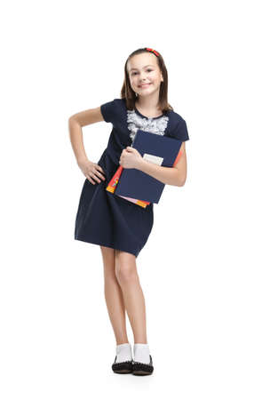 Joyful schoolgirl carries her books, isolated, white background