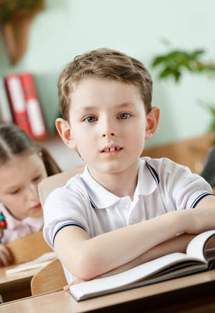 Little boy studies at school